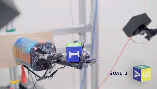 ИИ управляет роботизированной рукой, крутящей кубик, с невероятной ловкостью
